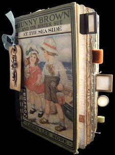 handmade altered-book journals. Click through to see the inside pages--they are worth it.