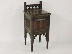 An oak Gothic Revival style bedside cabinet. Sold for £85