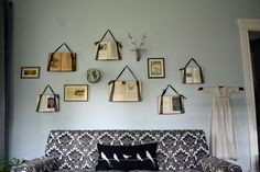 I love this idea of hanging books on the wall with ribbon.