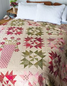 Large pinwheel blocks in subtle pinks, greens, and reds result in a pleasing quilt, but that's not all! What sets this quilt apart are the special folk art appliquéd blocks. Look for Brighton in Fall Scrap '14.