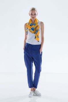 Elk | Lookbook | Slouchy bright blue pants worked in with a simple white tank top and bright silk gem print scarf