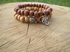 Check out this item in my Etsy shop https://www.etsy.com/listing/236756856/set-of-wood-bead-mala-bracelets-buddha