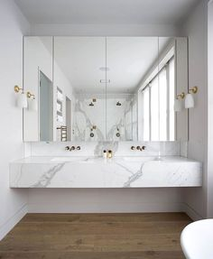 LOVE. Perhaps brass would date but love the marble and white and modern 'block' feel of the sink
