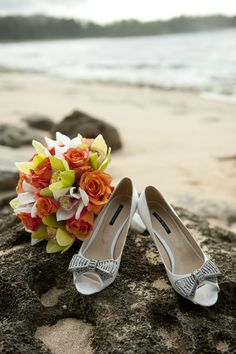 Turtle Bay Resort's beach backdrop is the perfect backdrop for this stunning bouquet and pair of wedding shoes. Photo by Fisheye Studio Photography www.fisheyestudio.com. Wedding planner on site Tori Rogers www.hawaiianweddings.net