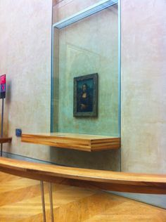 Looking at the Mona Lisa in the Louvre museum