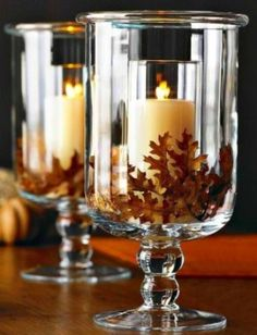 Put a smaller glass candle holder inside a large one, and put fall leaves in between