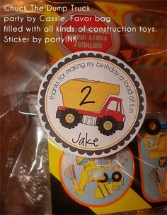 Bag filled with construction party favors using the Construction Dump Truck design.  Personalized stickers by partyINK.