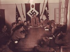 Boys of the Hitler Youth gather in their local chapter's headquarters for a meeting to discuss their upcoming activities for the week.