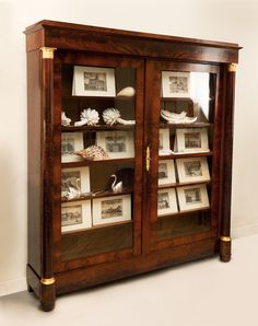 FRENCH EARLY 19TH CENTURY BOOKCASE. Circa 1825...perfect to showcase my bird nest collection.