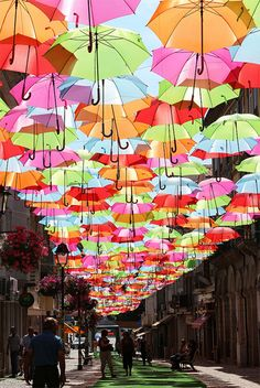 colorful umbrellas - I want to do this with mini ones in the hallway from the kids room