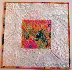 Classroom sample by Sarah Ann Smith, to test different threads. This would be a fun exercise, using a square of large print fabric and continuing the motif in the border with quilting.