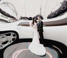 One of our happy couples on their wedding day with their white super stretch Chrysler 300 limousine #whitewedding #weddingphotoidea  www.aleadinglimo.com