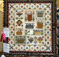 Love this quilt is called Letter Carriers by Janet Stone, Overland Park, KS. The ribbon is for Exemplary Machine Quilting.