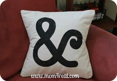 Stenciled Ampersand Pillow - create your own stencil with freezer paper and iron onto fabric.  Very cool and easy!