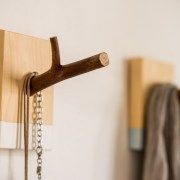 Wood single hook rack, the combination of raw wood, natural branches and a touch of modern paint, provide a contemporary design element to the living space.