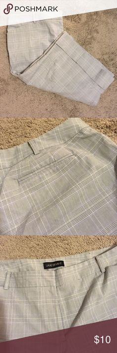 Cuffed dress Capri pants by Lane Bryant size 29. Lane Bryant cuffed capris that hit right at the knee. Size 20. 63% polyester 35% rayon 2% spandex. Flat front, mock slit pockets at the back. These are high waisted trousers. Very classy! Lane Bryant Pants Capris