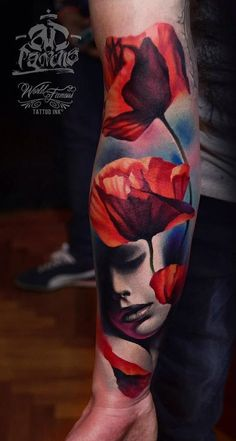 Beautiful looking sleeve tattoo. The design shows a group of red flowers facing the sun while its petals gently fall on the face of a sleeping woman.