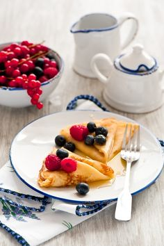 My favorite kind of breakfast: Crepes with honey and berries #breakfast