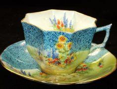 cup and saucer. Atlas Grimwades HP HOLLYHOCKS