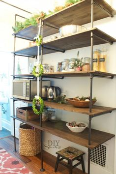 Christmas pantry with amazing pipe shelves at DIYShowOff #easyholidayideas