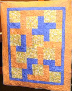 A kit quilt, beautifully long armed by Mary T.