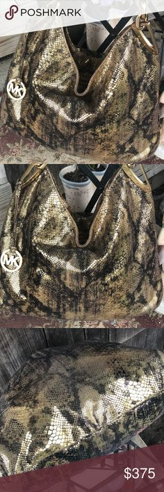 🔥RARE🔥RARE🔥, Ladie's GORGEOUS MK Python Leather This beauty is 🔥RARE🔥RARE🔥! 💯 % Authentic Michael Kors GORGEOUS , Python Leather large hobo bag ! As you see in pics the color's are just beautiful ! Gold hardware & zip closure , MK hanging fob charm 😍, handle has gold chain detailing ! This was one of my first MK bags & it's absolutley the bag for any season & any day ! Looks great with anything ! I love hobos , so anyone that loves hobo bag will ❤️ LOVE this beauty! Measure's…