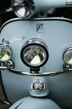 loved vespas since childhood in the 1960's.  a neighbor would take me for rides.  i stood  on the floor part within the handles.  wind in my face!  loved them since./Pale blue Vespa.