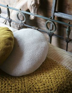 These crocheted cushion are fabulous {from Toast}