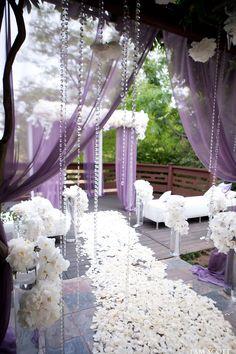 Gorgeous lavender and white outdoor wedding aisle. Karen Tran