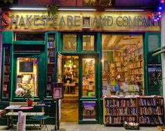 The Shakespeare and Company bookstore, in Paris, is across the Seine from Notre Dame. This photograph was taken at night, which accounts for the rich colors. by Robert Crum
