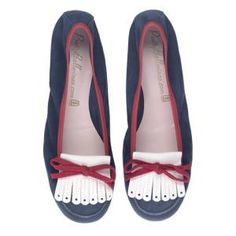 A soft moccasin, made on a ballerina last with a flexible rubber sole.  Soft suede in red white and blue