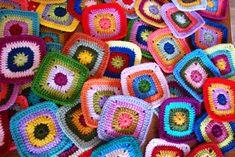 Sucrette's happy blanket WIP; using her basic solid square pattern here ~ http://www.lemondedesucrette.com/2011/04/15/grandma-and-me-blanket/   #crochet #square #motif #afghan #blanket #throw #pillow