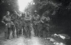 "3rd Platoon, Easy Company, 506th outside of Carentan, Normandy, June, 1944. Left to right:  Wayne ""Skinny"" Sis, ?, ? (possibly Campbell T. Smith), James ""Moe"" Alley, ? (possibly George L. Potter Jr.), Walter ""Blackjack"" Hendrix."