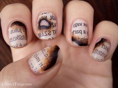 Burned paper fingernails - Boing Boing ~  Banned Books Week: burned paper fingernails from Glitterfingersss. Basically, you soak newspaper in alcohol, transfer the ink to your nails atop a light nude polish, paint in the burned marks, and add a topcoat.