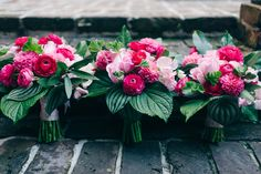 Bridal bouquets in various shades of pinks and seasonal foliage! Hot pink ranunculus, hot pink dahlias, blush roses, blush sweet peas and blush tulips are made up into these sweet bouquets. Seasonal New Orleans foliages include, hydrangea leaves, geranium leaves, magnolia leaves,  and calathea leaves.