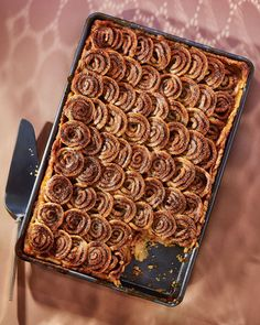 Cinnamon-Swirl Apple Slab Pie- Extra cinnamon-swirl dough slices like cookie dough -- and becomes crisp and caramelized in the oven, much like palmiers. Bake it on a parchment-lined baking sheet until very golden, about 12 minutes.