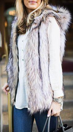 Emily Jackson is wearing a faux fur hooded vest from Free People