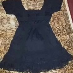 Victoria Secret peasant blouse/dress top Black with a crotched look on it. Has a crotched look very cute shoulders has a ruffle crotched have look at the bottom. Same at top and allot of other areas on it. Can be worn as a top or dress depending on your height. Its really cute. Good shape. Thanks Victoria's Secret Tops Blouses