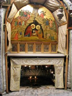The altar at the grotto of the Nativity in Bethlehem. The star under the altar is at the place of Jesus' birth.