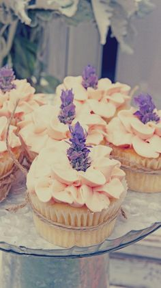 Loving these lavender and baby's breath flower topped cupcakes with ruffled frosting- bridal shower