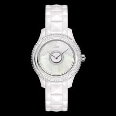 Dior VIII Grand Bal modèle 'Plissé' Ø 38 mm, 'Dior Inversé' calibre automatic movement, oscillating weight in white gold, decorated with white Australian opal inlay and diamonds, high-tech white ceramic and white gold case and bracelet, white mother-of-pearl bezel with baguette-cut diamonds, crown set with a diamond, white mother-of-pearl and diamond dial, anti-reflective sapphire crystal, opalescent case-back. Discover more on www.dior.com