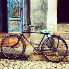 Dilapidated buildings, cobble streets and a bike. I heart Havana! Havana, Cuba