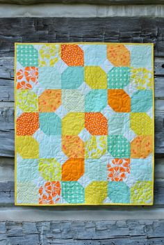 Citrus Mint Baby Quilt - Make a quick and fat quarter friendly baby quilt pattern with this half snowball block! You can personalize with your choice of colors and whip up this easy quilt pattern in a weekend. Created in beautiful and sweet summertime colors, this lovely little quilt makes a fantastic baby shower gift. The neutral and bright colors in the Citrus Mint Baby Quilt make it the perfect quilt for boys and girls. If you would prefer a subtler quilt, try out some pastel prints inste...