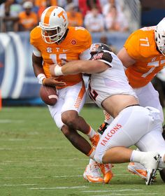 NASHVILLE, TN - SEPTEMBER 05: Kyle Bobo #32 of the Bowling Green Falcons sacks Joshua Dobbs #11 of the University of Tennessee Volunteers during the first half at Nissan Stadium on September 5, 2015 in Nashville, Tennessee. (2528×3000)