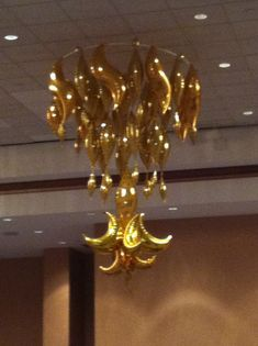 Party ceiling decor that makes an impact. 18 foot balloon chandelier created from tapers and curves for a gala.  Designed and executed by Alissa Lane