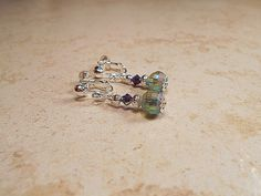 Hey, I found this really awesome Etsy listing at https://www.etsy.com/listing/247982447/purple-blue-green-dangle-screw-back