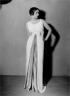Designer Elsa Schiaparelli modeling one of her evening dresses, c.1930
