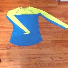 M Nike run shirt Worn once size medium Nike running shirt. Reflective detail on sleeves and in the back. Excellent condition. Nike Tops