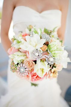 Wedding bouquet with brooches- love how fresh and white it is