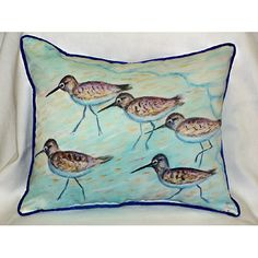 We love these fun, 15 x 22 coastal indoor-outdoor pillows with a series of sandpipers skittering along the shore.
